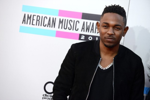 Kendrick Lamar arrives at the American Music Awards at the Nokia Theatre L.A. Live on Sunday, Nov. 24, 2013, in Los Angeles. (Photo by Jordan Strauss/Invision/AP)