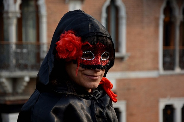 A performer, worn a mask and an interesting costume, poses near the Cannaregio Canal for the Carnival Regatta during the Venice Carnival on January 24, 2016 in Venice, Italy. The 2016 Carnival of Venice will be accepting guests till 9th of February with varied activities including balls, parade, dance. Photo by Baris Seckin/AA/ABACAPRESS.COM