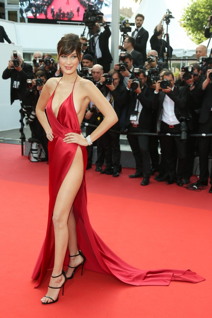 Bombshell Bella Hadid in underwear free red dress attends 'The Unknown Girl (La Fille Inconnue)' Premiere during the annual 69th Cannes Film Festival at Palais des Festivals on May 18, 2016 in Cannes, France. Pictured: Bella Hadid