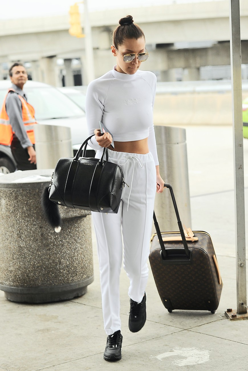Bella Hadid looking stunning in an all white crop top jumpsuit as she heads to the airport in NYC Pictured: Bella Hadid